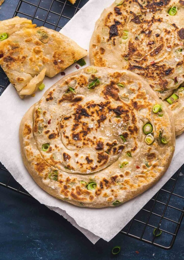 Savory Chinese Scallion Pancakes on parchment paper