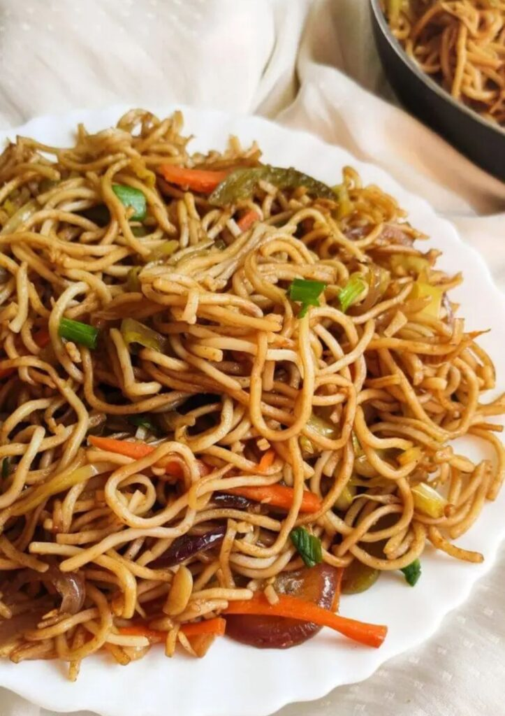 vegetable chow mein on a large serving plate