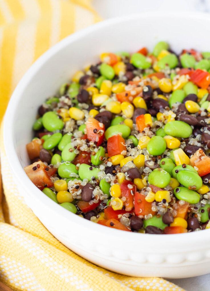 large serving bowl with black bean edamame salad