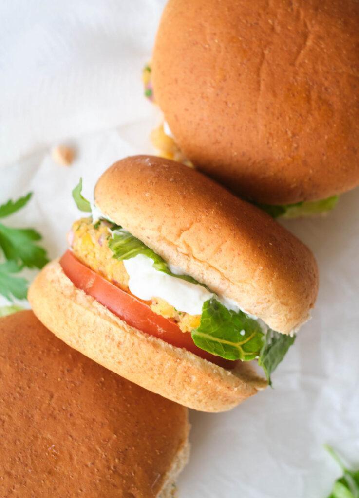 3 vegetarian burgers on whole wheat buns