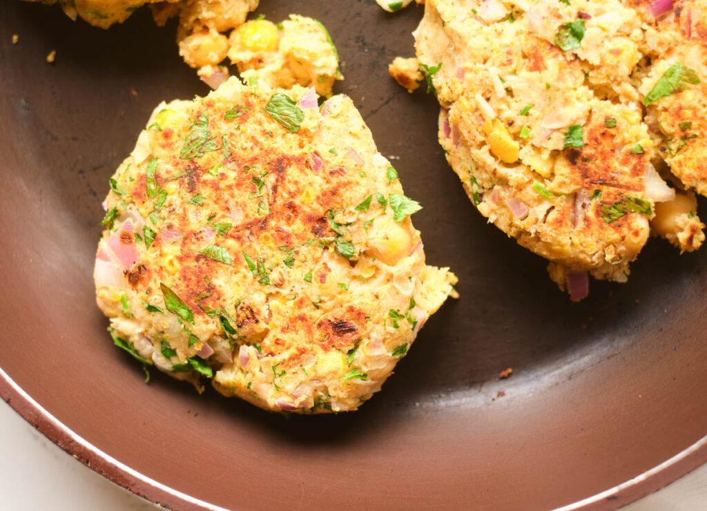 chickpea patties browned in skillet