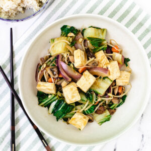vegetable chop suey with vegetables in white bowl with chop sticks
