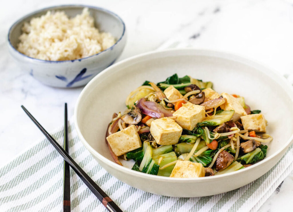 vegetable chop suey with tofu served with side of rice