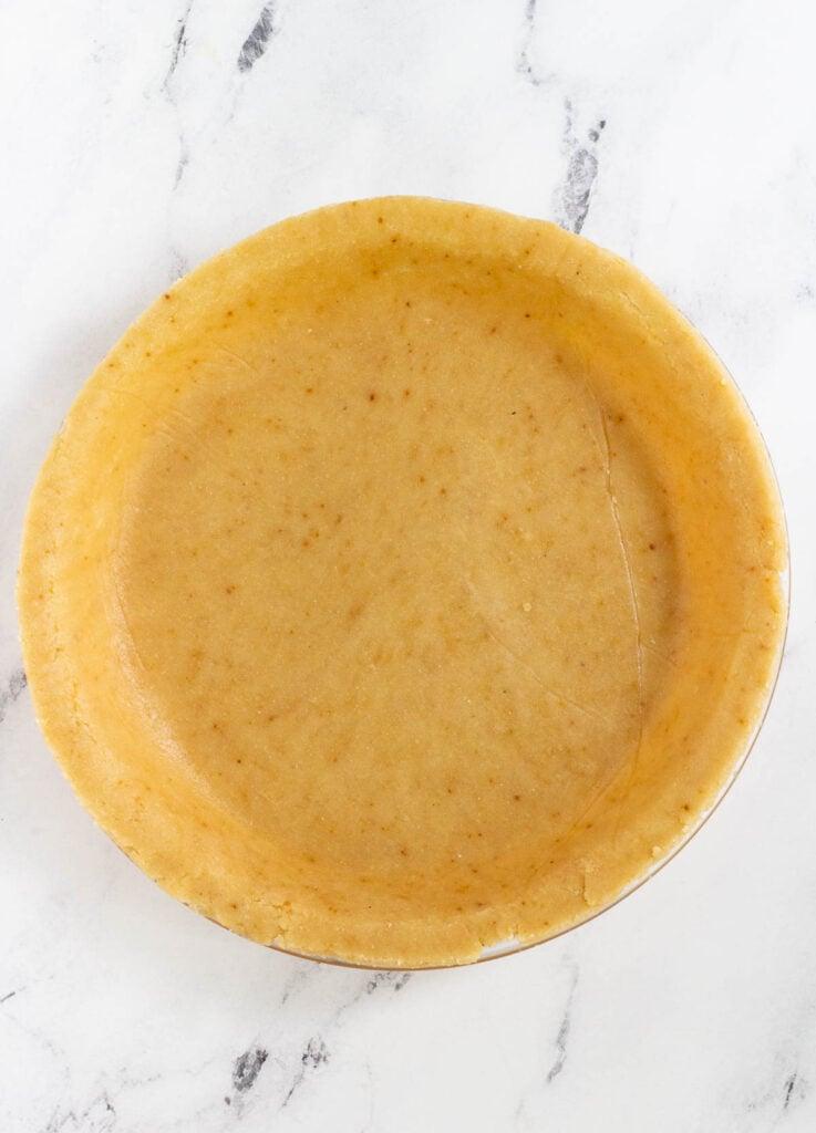 unbaked almond flour pie crust in pie dish