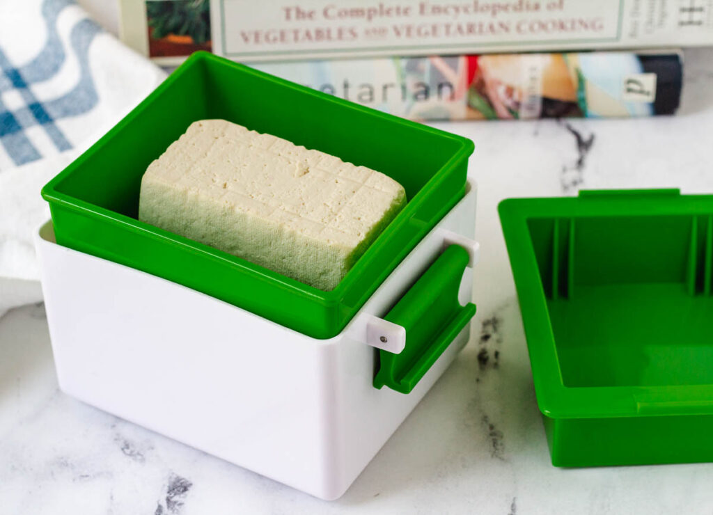 tofu block inside of tofu press