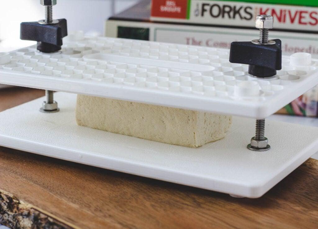 tofu between two plastic boards (ez press screw tofu press)