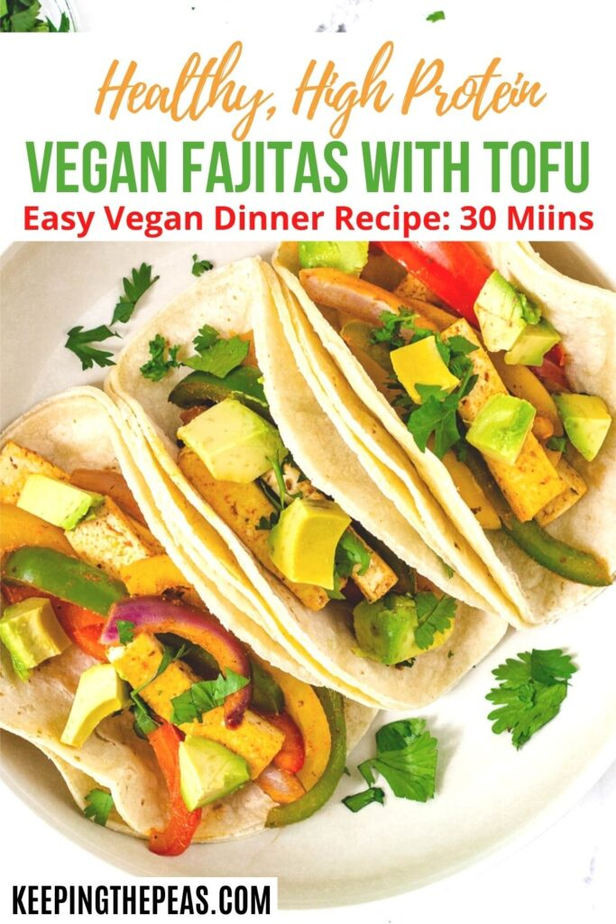 corn tortillas filled with vegetables and topped with avocado