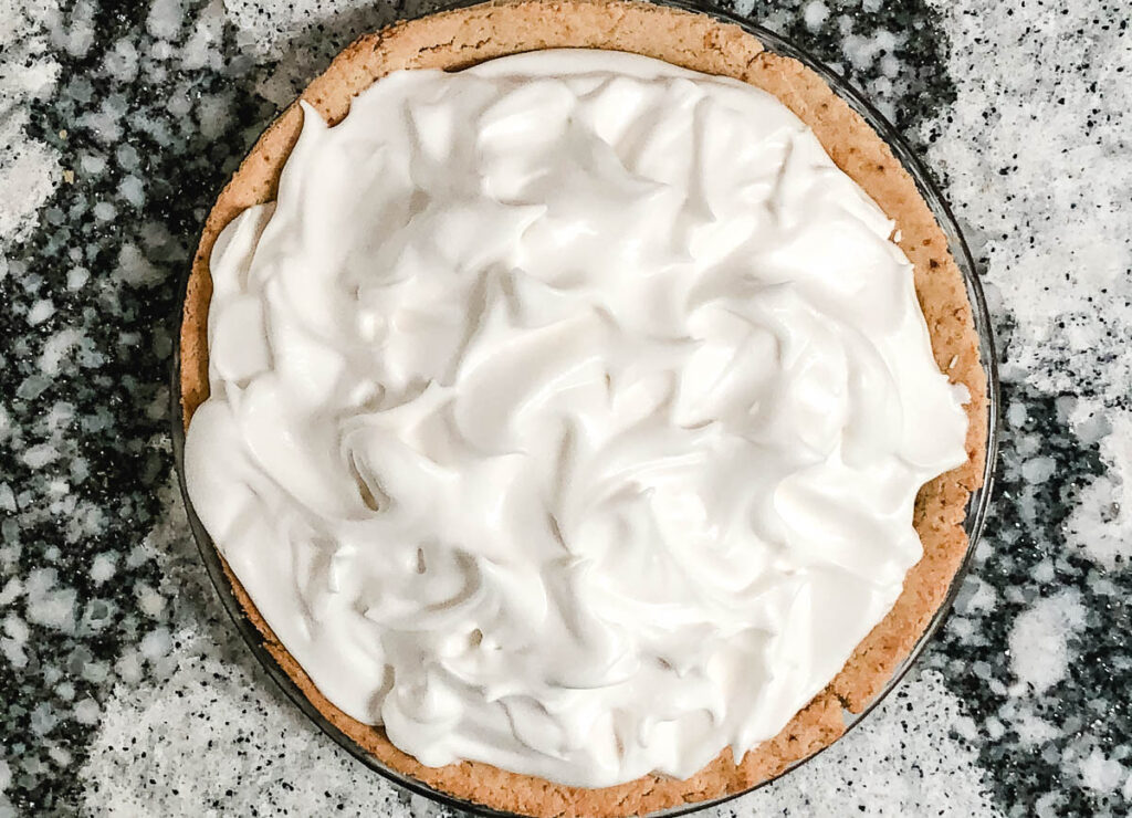 meringue topping on pie with lots of edges and peaks