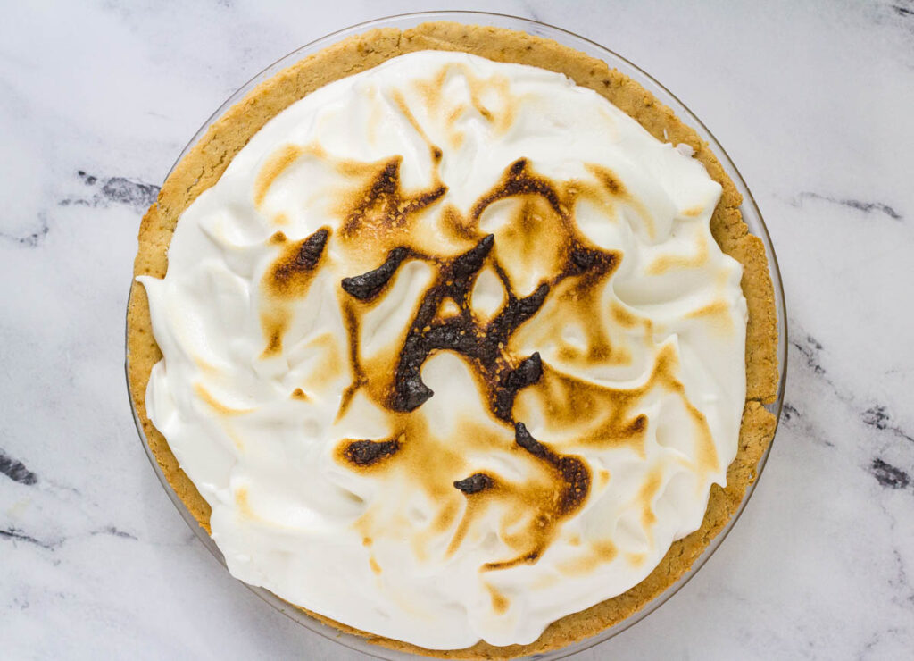 browned meringue pie out of the oven