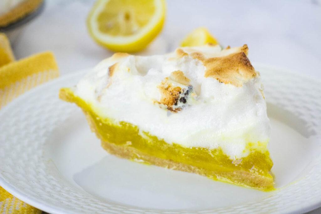 slice of vegan lemon meringue pie on white plate