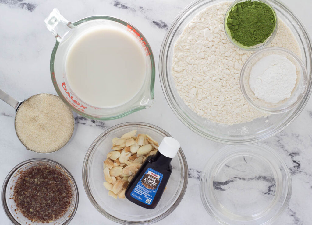 almond milk, flour, matcha, baking powder and salt, coconut oil, almond extract, sliced almonds, flax egg, sugar