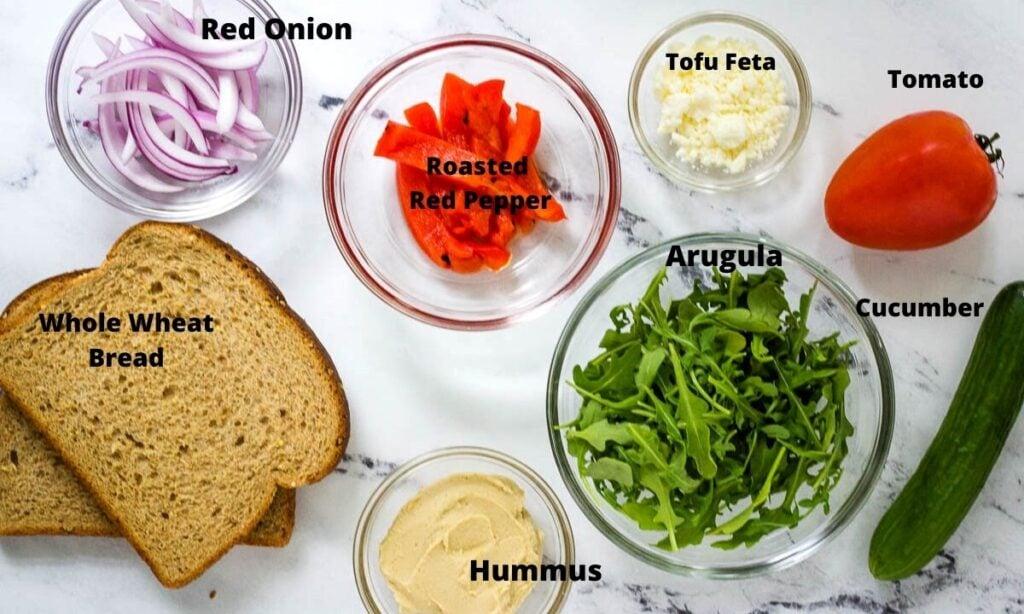 red onion, roasted red peppers, tofu feta, roma tomato, cucumber, arugula, hummus, and whole wheat bread