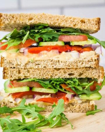copycak Panera mediterranean veggie sandwich cut in half with two halves stacked on top of one another