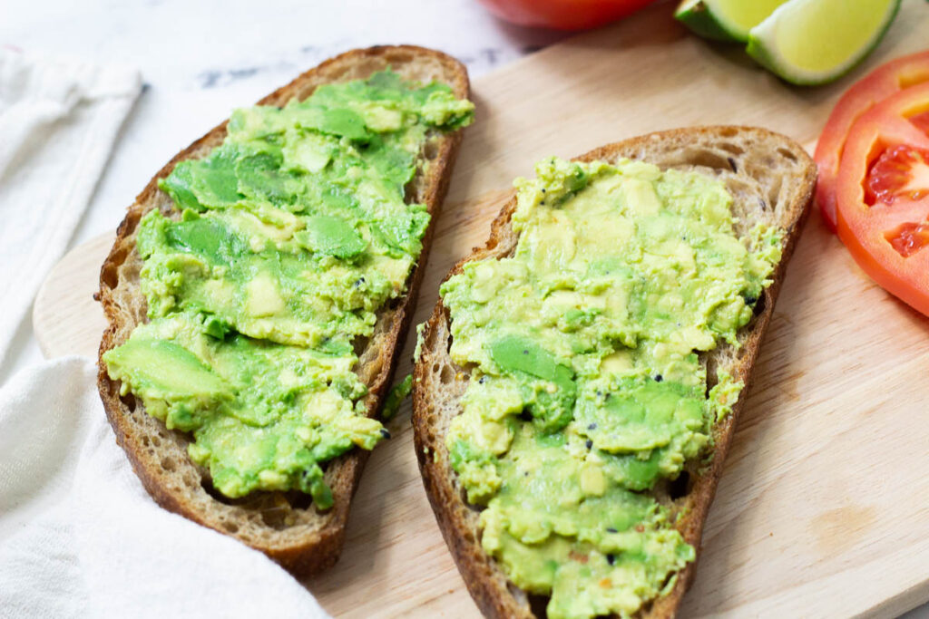 mashed avocado spread on top of whole grain toast