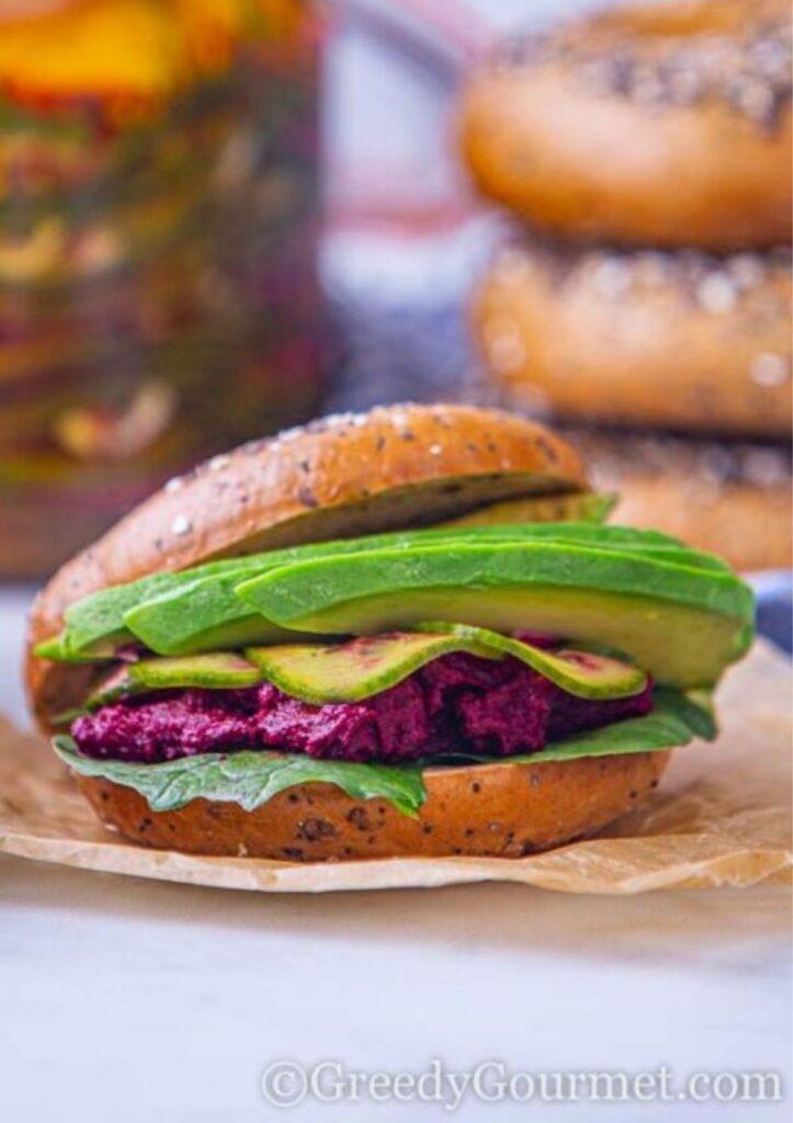 beet hummus sandwich with avocado on bun