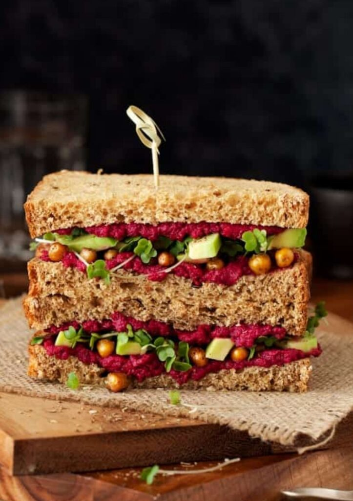 beet and chickpea sandwich with sliced avocado