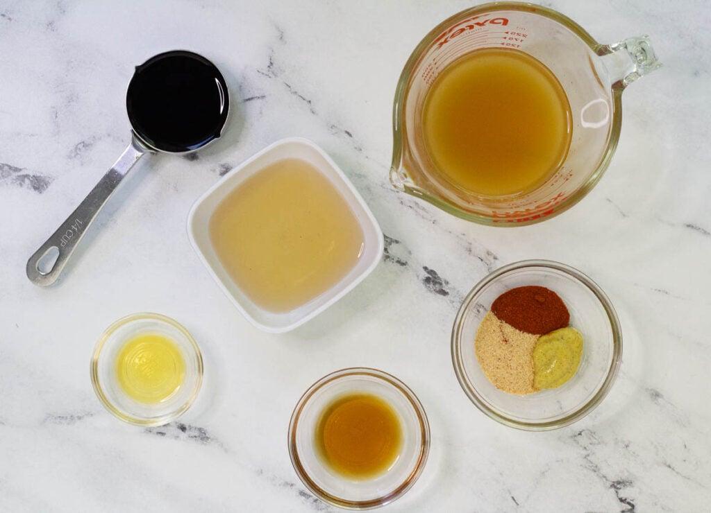 Marinade ingredients: soy sauce, apple cider vinegar, vegetable stock, maple syrup, liquid smoke, paprika, mustard, and garlic powder.
