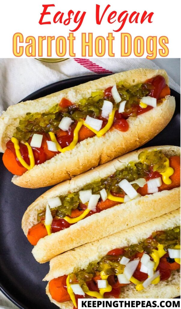 Carrot dogs on black plate.