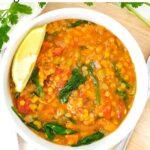 Vegan lentil soup in white bowl