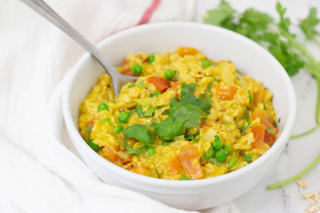 Bowl of savory curry oatmeal.