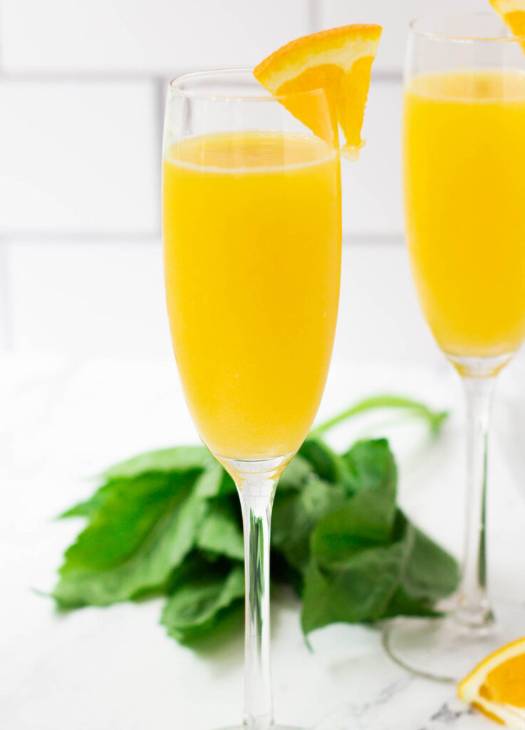 Champagne flute filled with a mimosa mocktail.