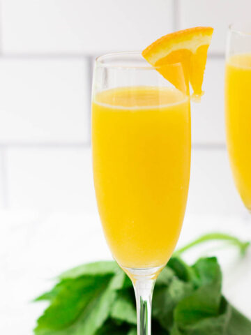 mimosa mocktail with wedge of orange