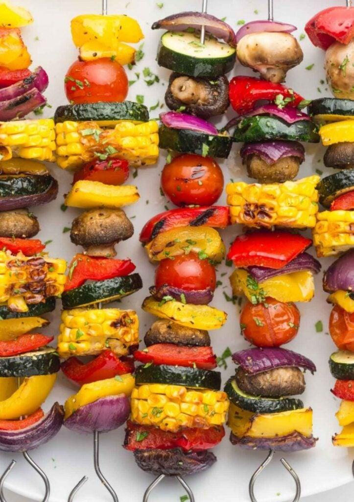 Veggie skewers with corn, mushroom, tomato, and zucchini.