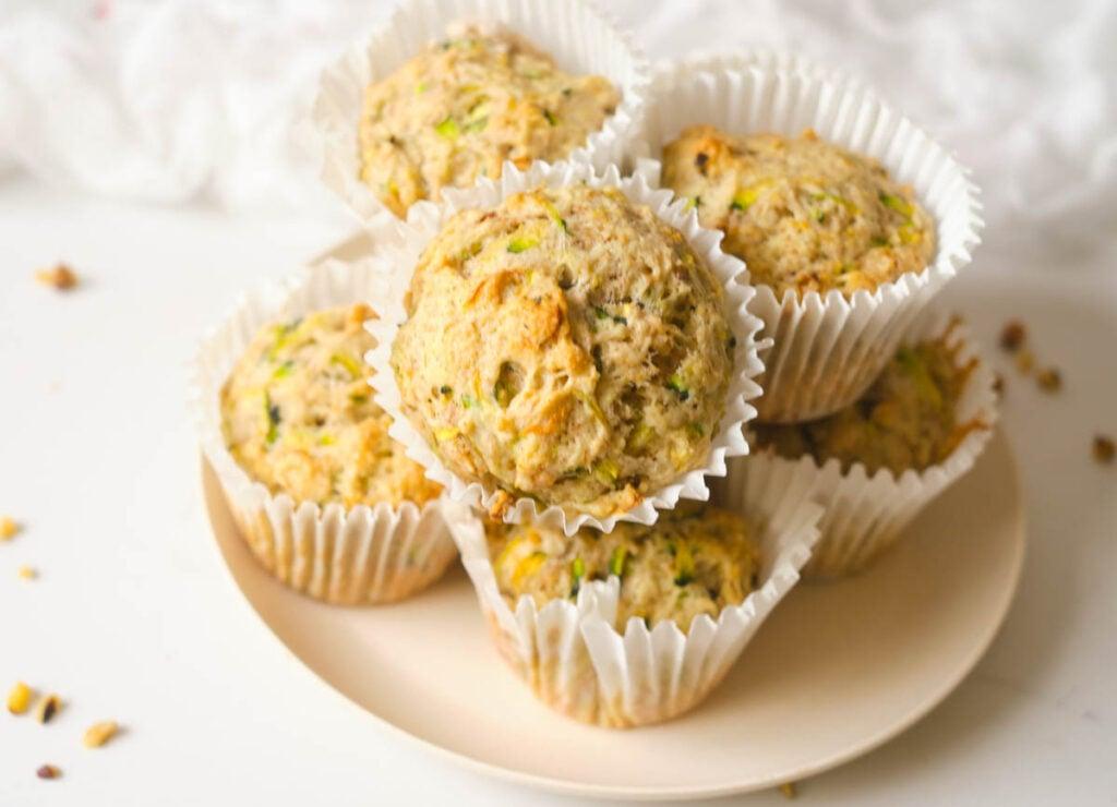 Zucchini muffins on pink plate.