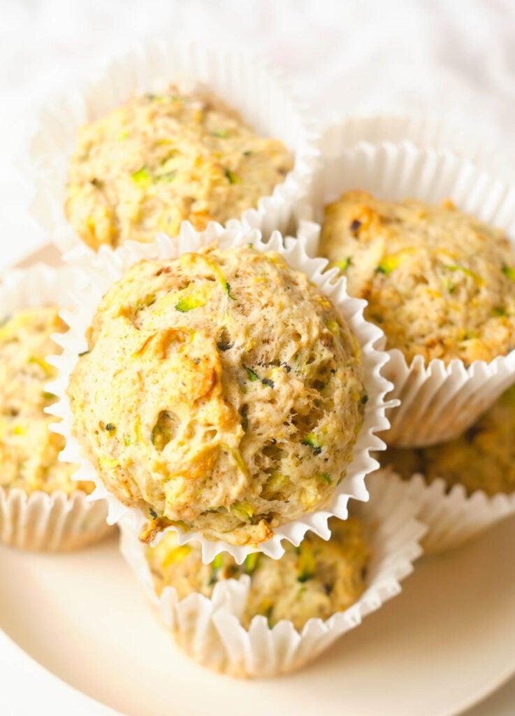 Zucchini muffins on a plate.
