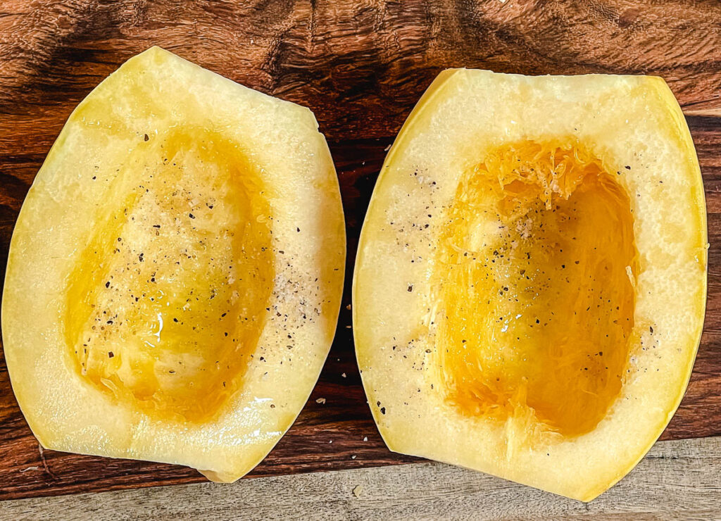 Spaghetti squash halved drizzled with olive oil and sprinkled with salt.