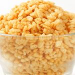 Bowl of rice krispie cereal in glass bowl.