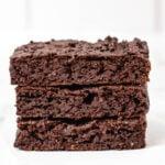 Stack of three healthy vegan brownies.