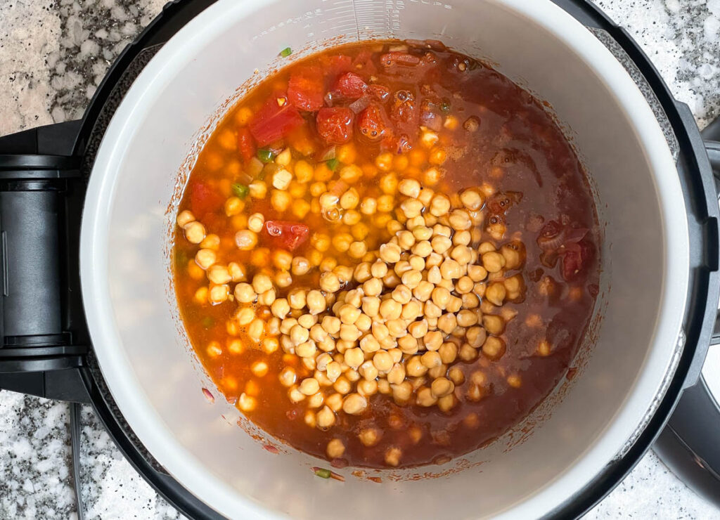 Chickpeas added to tomato and spices to instant pot.