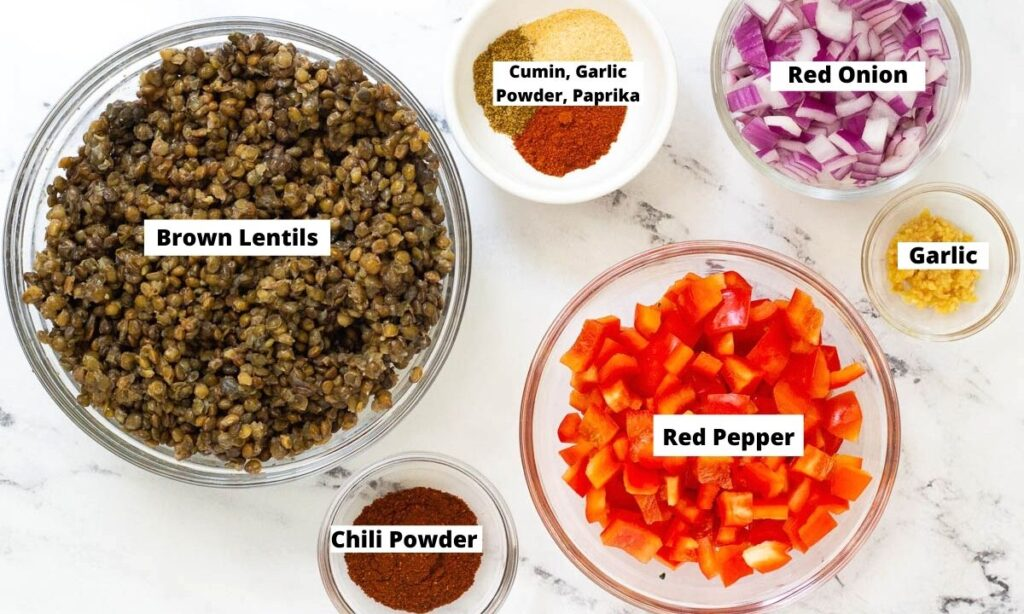 Lentil Taco Meat Ingredients: cooked brown lentils, cumin, garlic powder, paprika, red onion, garlic, red pepper, and chili powder.