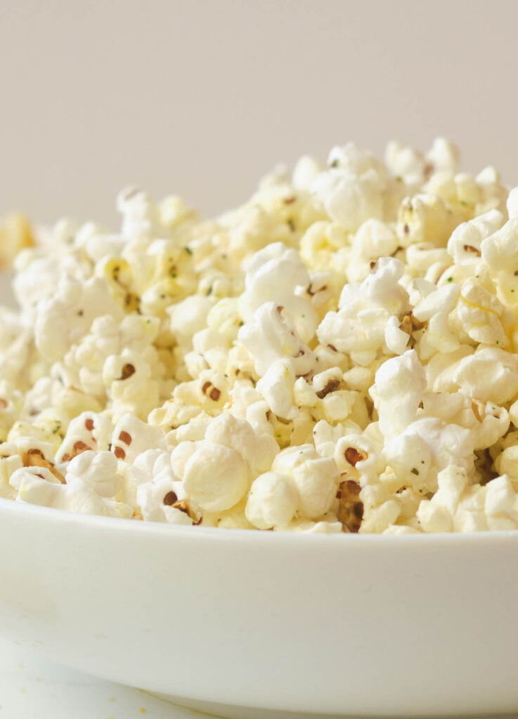 Close up of popcorn in white bowl.