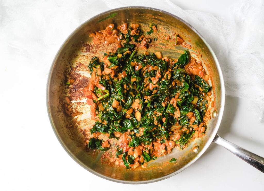 Chopped spinach added to pan with spiced onions.