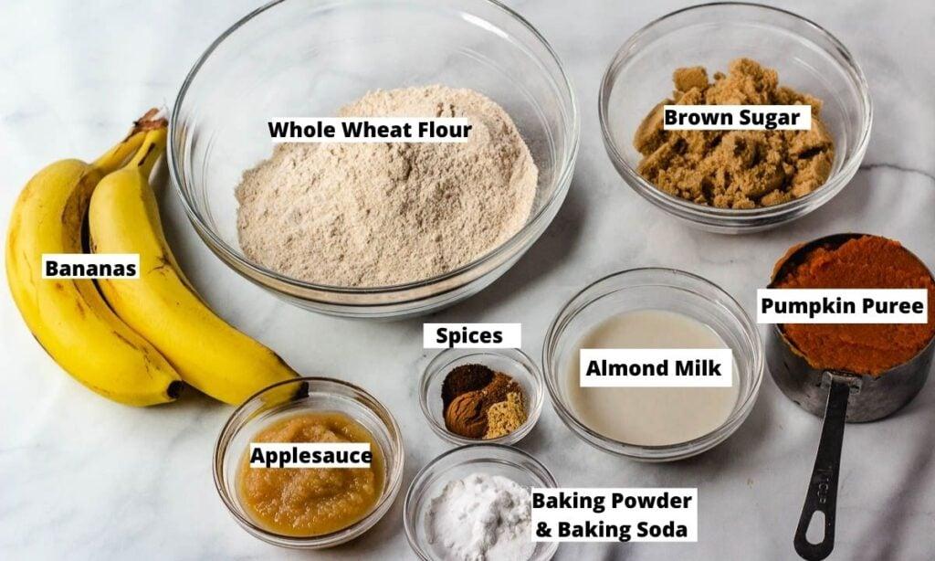Vegan Pumpkin Muffin Ingredients: Whole wheat flour, brown sugar, pumpkin puree, almond milk, baking powder, baking soda, spices, applesauce, bananas.