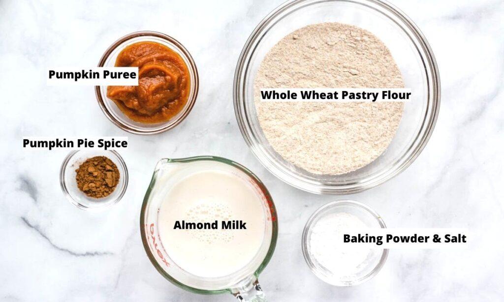 Pumpkin pancake ingredients: pumpkin puree, whole wheat pastry flour, pumpkin pie spice, almond milk, baking powder, and salt.