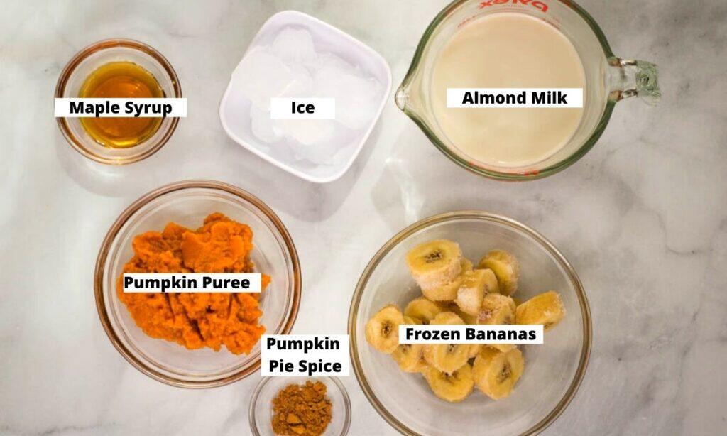 Maple syrup, ice, almond milk, frozen bananas, pumpkin pie spice, and pumpkin puree.