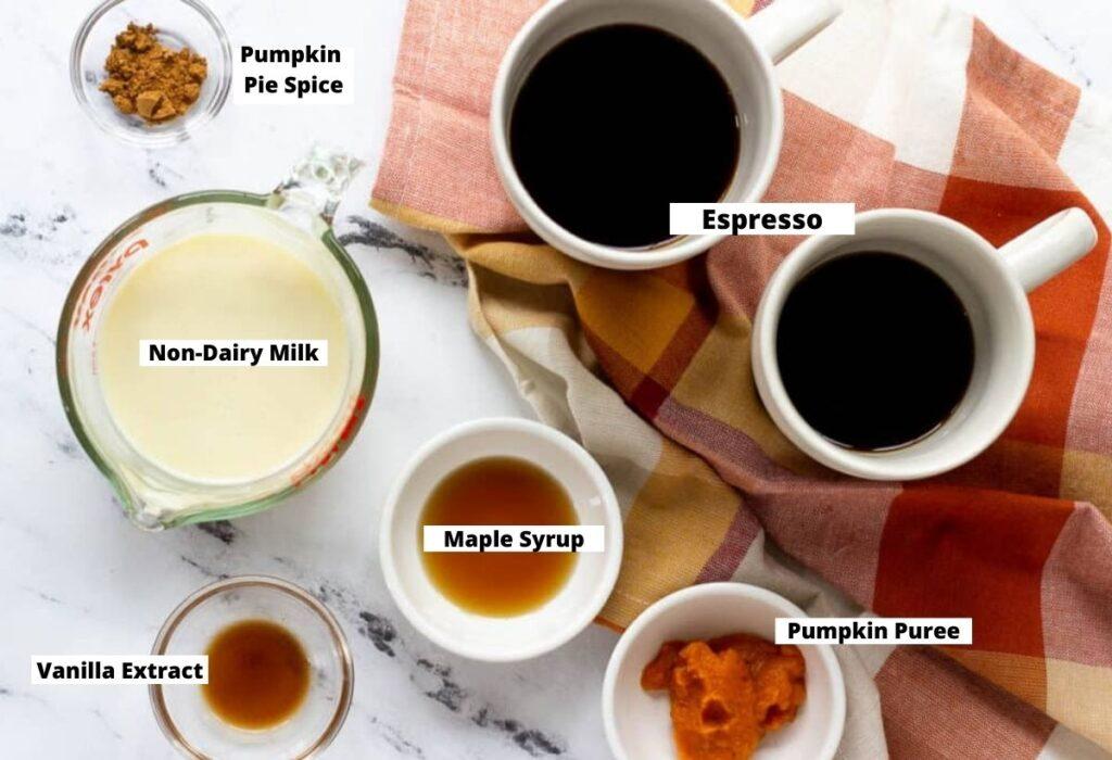 Pumpkin latte ingredients: pumpkin pie spice, espresso, non-dairy milk, maple syrup, vanilla extract, pumpkin puree.