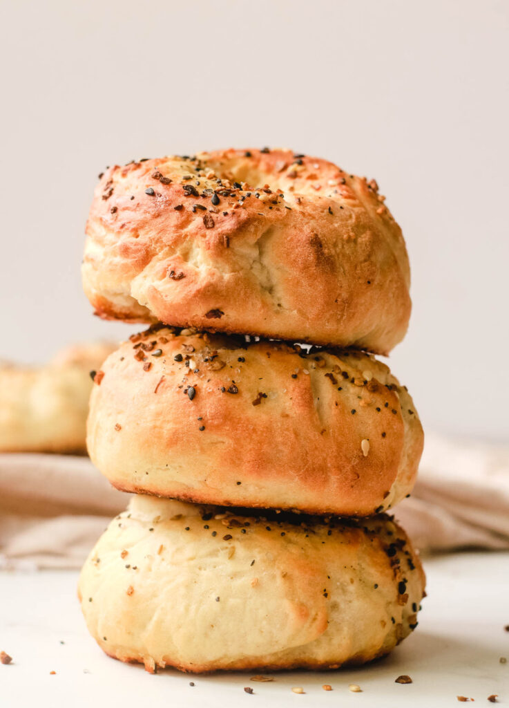 Stack of three everything bagels.