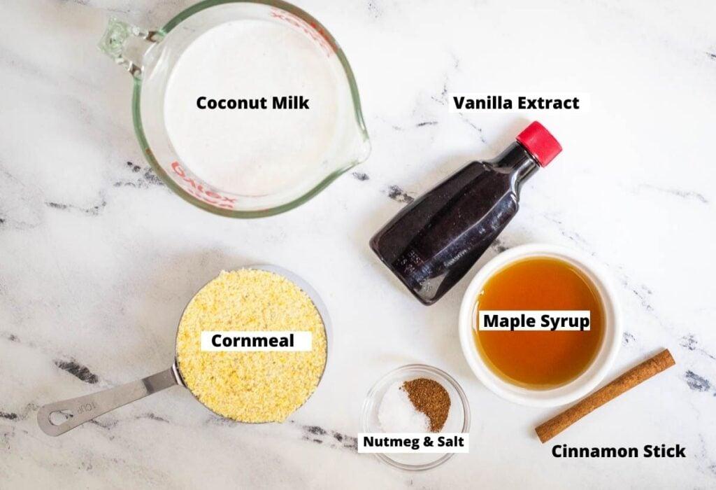 Coconut milk, vanilla extract, maple syrup, cinnamon stick, nutmeg, salt, and cornmeal.