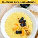 Cornmeal porridge topped with blueberries and orange slices.