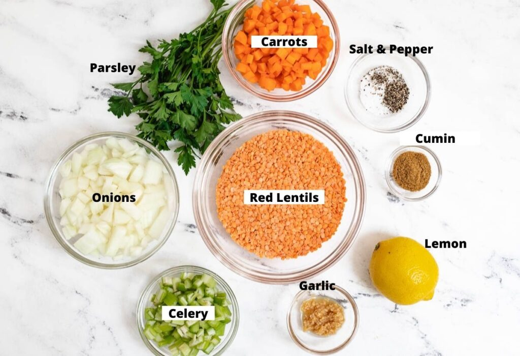 Red lentils, carrots, salt and pepper, cumin, lemon, garlic, celery, onions, and parsley.
