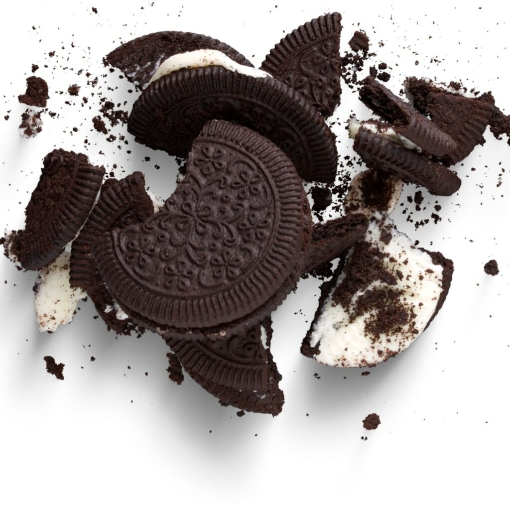Oreo cookies crushed into pieces on white background.