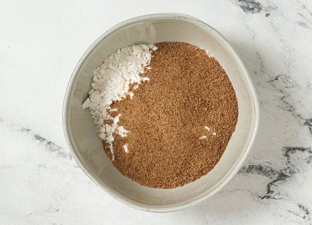 Flour, sugar, baking powder, and salt in bowl.