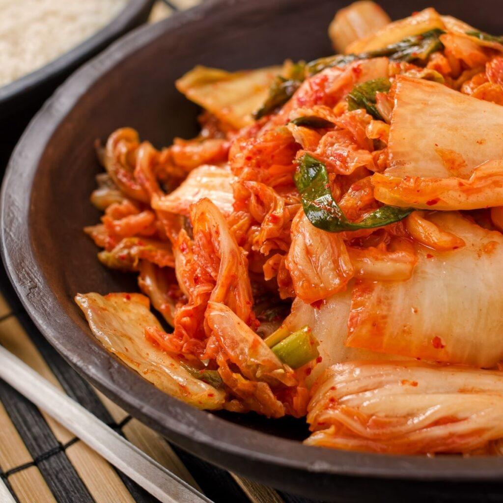 Kimchi in black bowl.